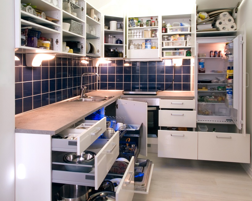white kitchen with drawers open