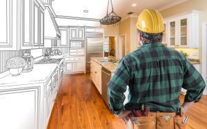 contractor looking at custom kitchen drawing