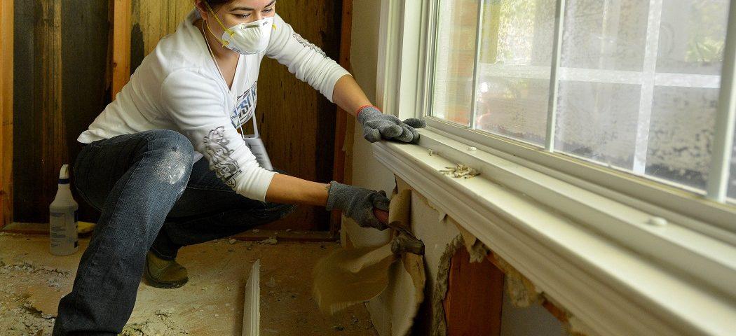 worker repairing flood damage